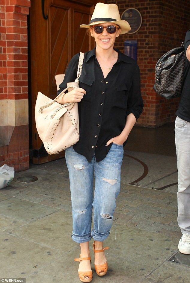 Hats off to her! Kylie Minogue looked cool and casual as she arrived at London's St Pancras International via the Eurostar on Thursday