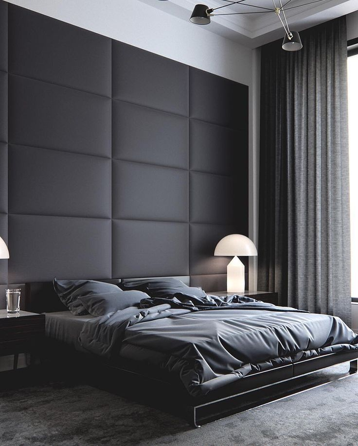 Black bedroom with soft wall and black bedding