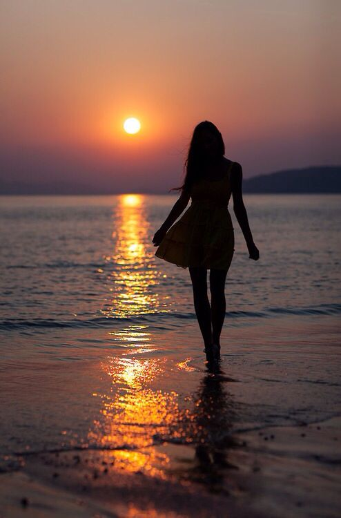 Image result for woman walking on beach at sunset