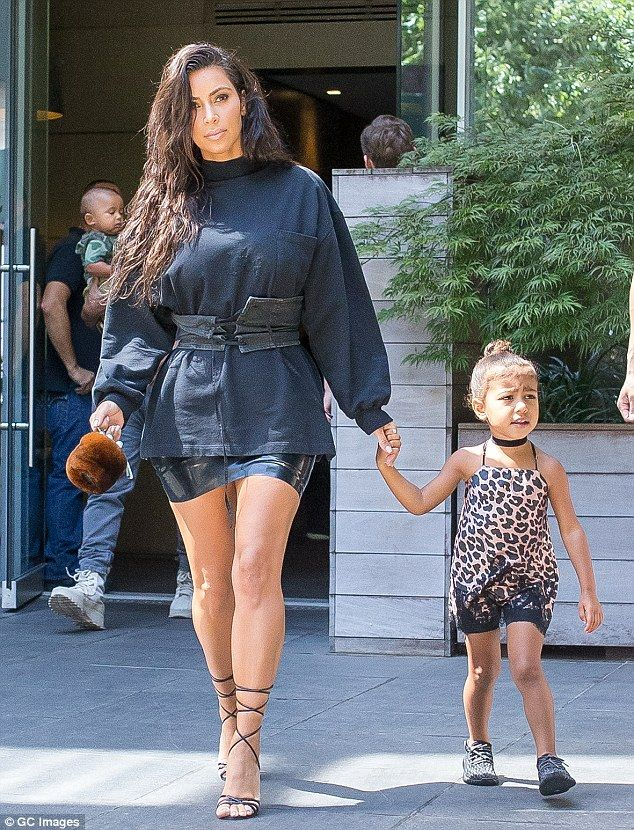 Here you go baby: Kim led her adorable three year old by the hand...