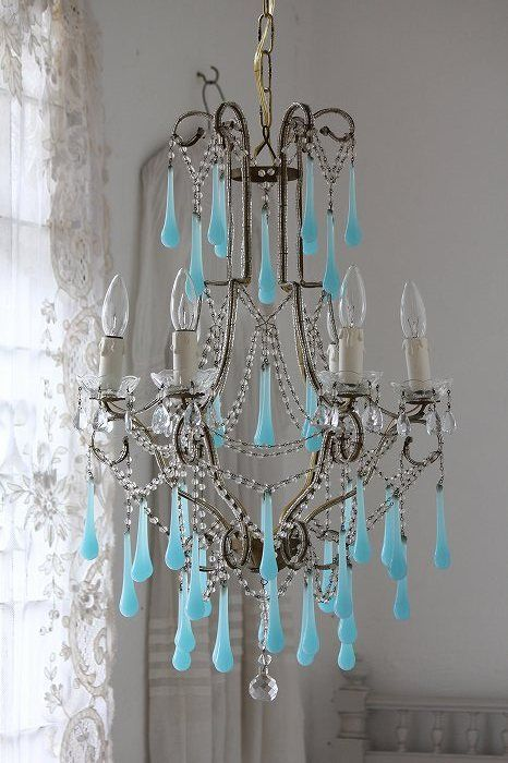 Oh my goodness!  I have a sconce similiar to this chandelier...let the adventure begin to find the blue crystals!!