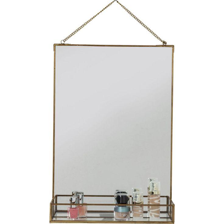 En liten spegel med hylla i glas och tunn fin ram i ärgad mässing. Perfekt spegel för lilla gästtoaletten eller som badrumsspegel.