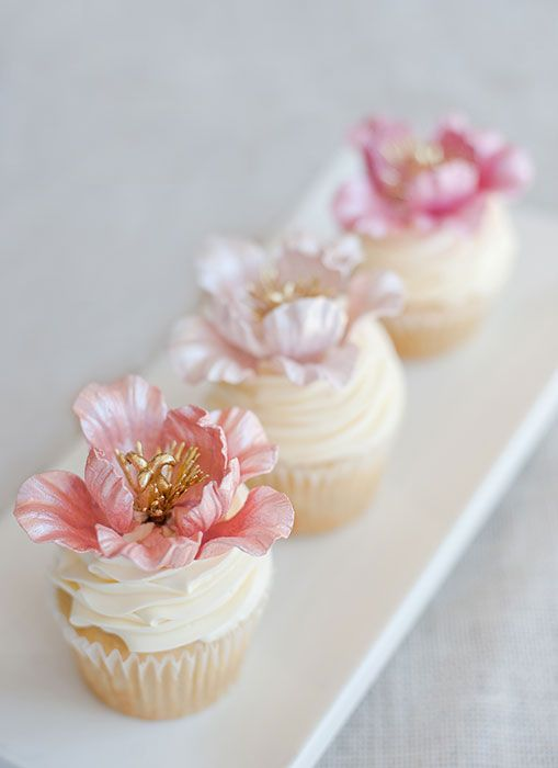 Elegant floral cupcakes-the cupcake should have been the standard size-the flowers are gorgeous!