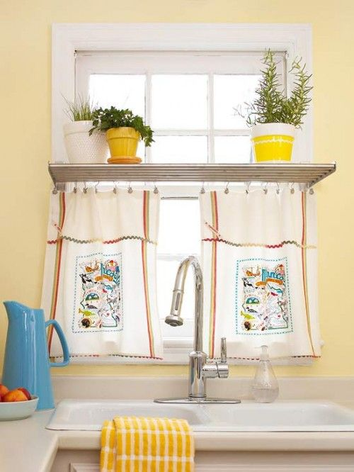 Tea Towel Window:   Using two kitschy tea towels clip drapery hooks to the top edge of a dishtowel and hang from a cafe curtain rod.   Idea from bhg.com.