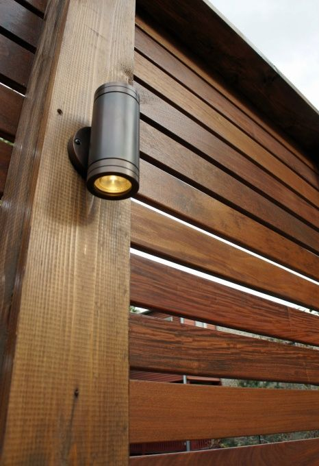 "Ipe slat fence.  Lights do not shine in anyone's eyes and create a great ""glow"" that makes everyone look good in the evening!"