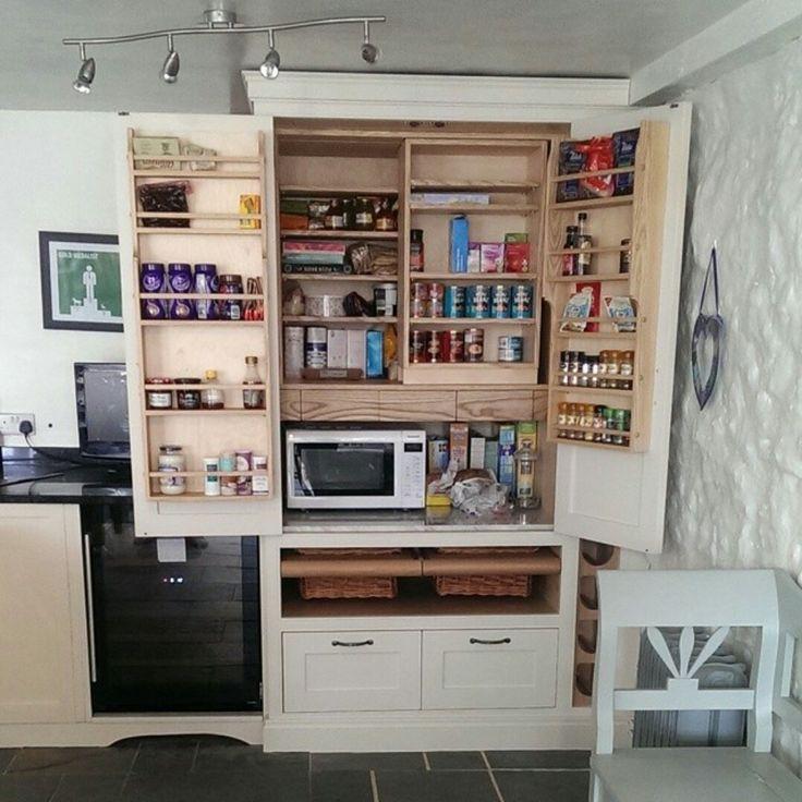 Bespoke larder cupboard with basket drawers, slide-by shelves, door racks, marble shelf and internal plug socket for microwave. www.instagram.com/hallwoodfurniture
