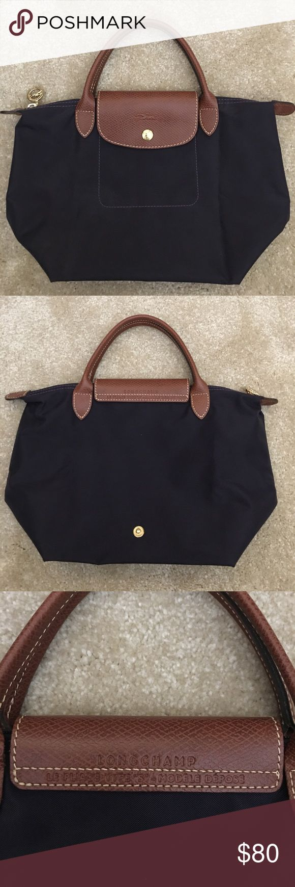 Authentic Longchamp Le Pliage. Size S handle bag. Bilberry color (deep purple/blue) Used only a few times. Purchase from Nordstrom. In great condition, very clean. Will ship with price tag. Longchamp Bags Satchels