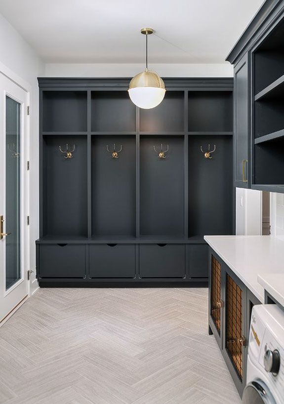 laundry room with tall black built-in storage with brass fixtures and lighting. / sfgirlbybay