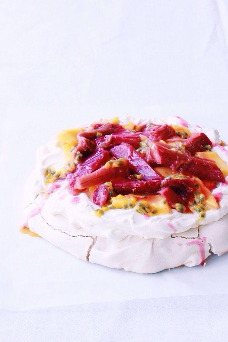 Pavlova with Rosemary Poached Rhubarb, Mango + Passionfruit