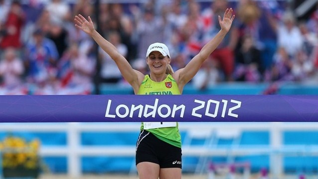 Laura Asadauskaite of Lithuania crosses the line in first place to win the gold medal in the women's Modern Pentathlon on Day 16.