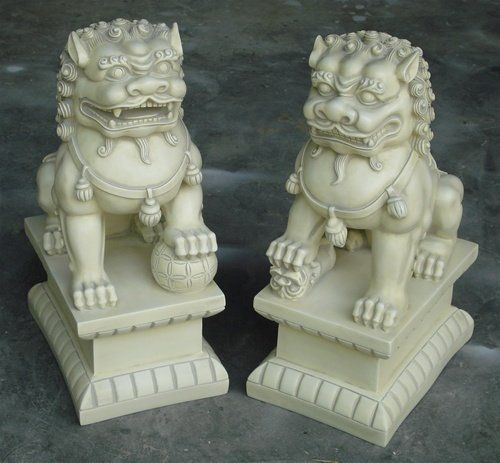 """Asian Foo Dogs (Fu Dogs) Garden Statues, Pair, Stone Finish by Ancient Treasures. $200.84. Guardian Lions are sacred to Buddhism, where they are seen as guardians of the Teaching (Dharma) and their """"Lion's Roar"""" symbolizes the voice of the Teachings of Buddha resounding in all directions. Guardian Lions are the protectors of sacred buildings and are seen as emblems of valor and energy. Sculptured lions are frequently placed at the gates of the temples, porticoes of the hou..."""