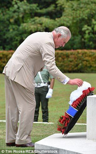 Prince Charles lays a wreath at the Cross of Sacrifice at the Taiping Commonwealth War Graves Cemetery