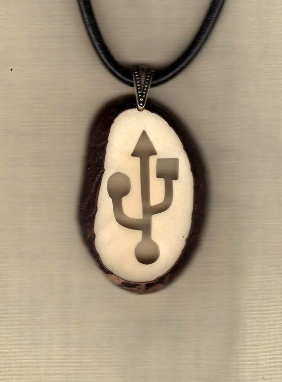 Check out this item in my Etsy shop https://www.etsy.com/listing/158009542/tagua-pendant-necklace-usb-symbol