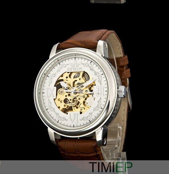 Montre mécanique SEWOR Crown IV, bracelet cuir marron, cadran squelette doré et blanc.
