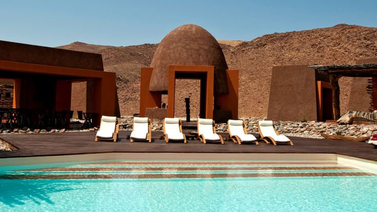 The swimming pool and open-air rest areas at Okahirongo Elephant Lodge #namibia #luxuryretreats