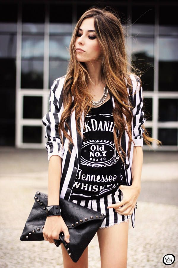 black and white stripes cardigan with matching black and white stripes shorts and, of course, a Jack Daniels tank with a black leather clutch