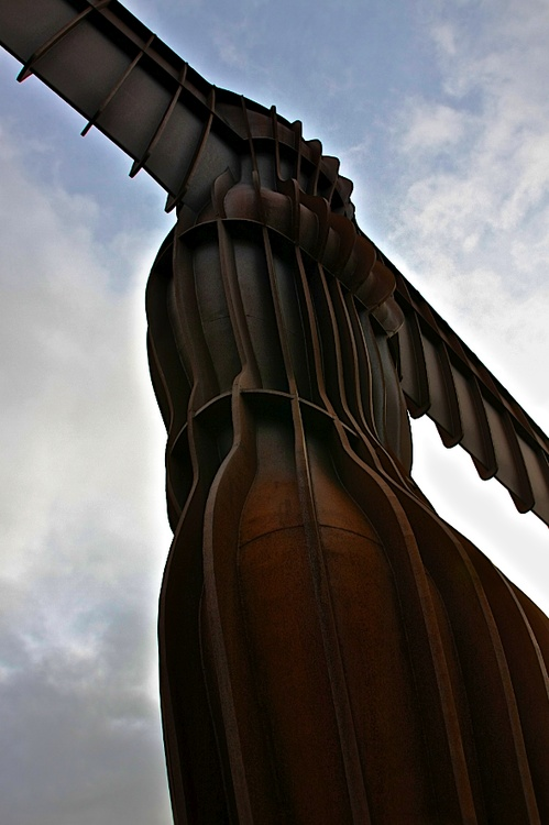 TheAngel of the North ~This amazing installation is located inGateshead, Tyne and Wear, England. It's a steel sculpture of an Angel 66ft tall, with wings measuring 177ft across. The Angel weighs in at 200 tonnes and 600 tonnes of concrete was used to form the foundation! It's a really impressive sight, you round a corner on an otherwise boring stretch of the A1 motorway and she stands on top of a hill at the southern edge of Low Fell.   Artist- Antony Gormly.    photo- D.Bryant
