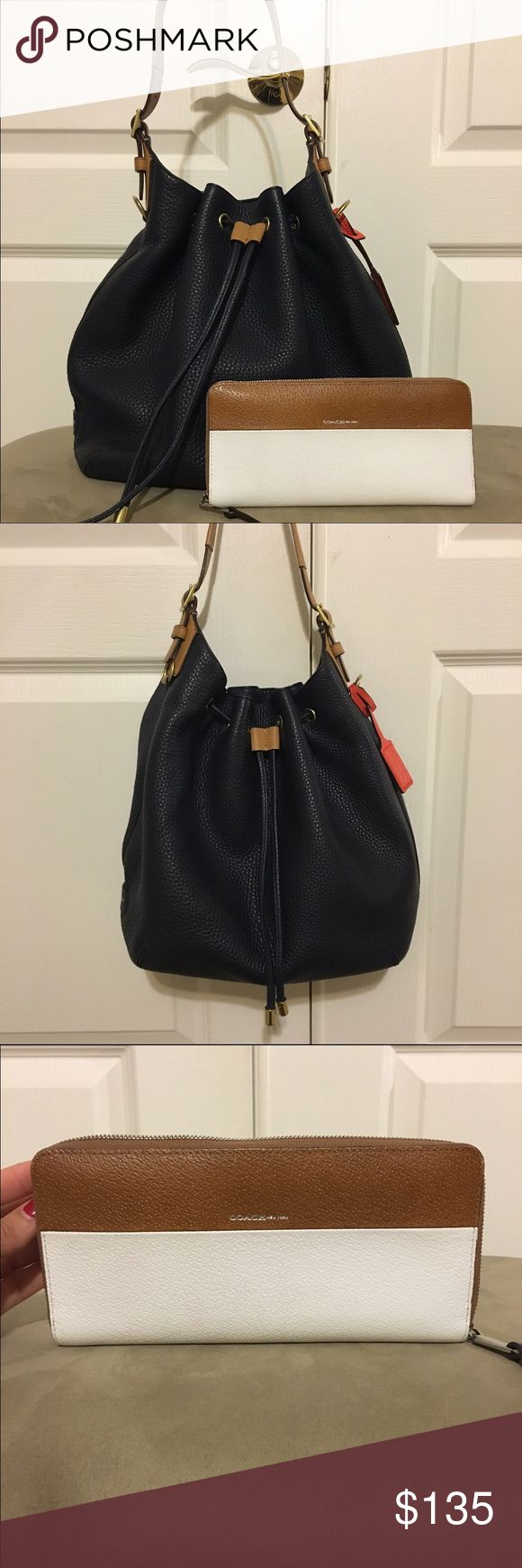 Coach Legacy Drawstring & Accordion Wallet Midnight blue pebble leather Coach drawstring and color block wallet. Prior owned and gently used but still in great condition. Coach Bags Satchels