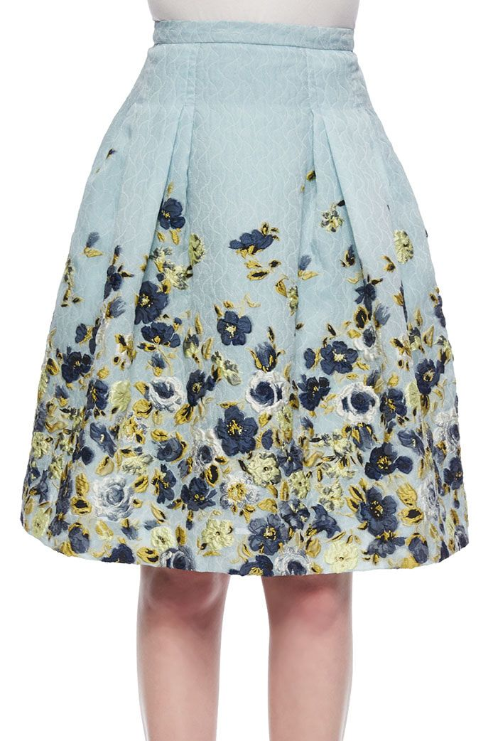 The outfit consists of the Carolina Herrera Flower Fil Coupe Party Skirt  and a navy Felipe