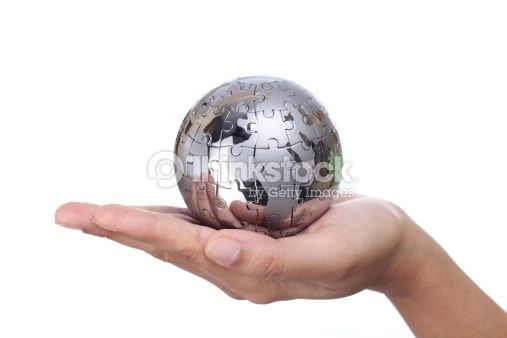 Stock-Foto : Hand holding metal puzzle globe