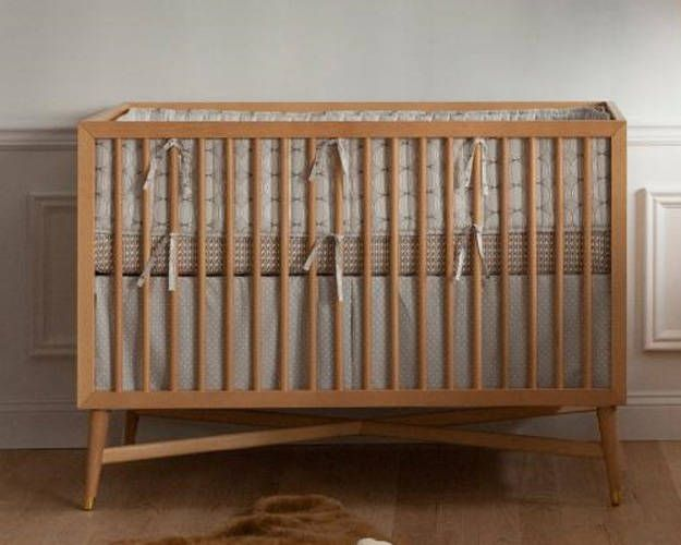 DwellStudio offers a simple, classic crib. With clean lines, tapered legs, and hardwood construction, the Century Crib has a look that recalls midcentury designs. Toddler bed conversion kit available