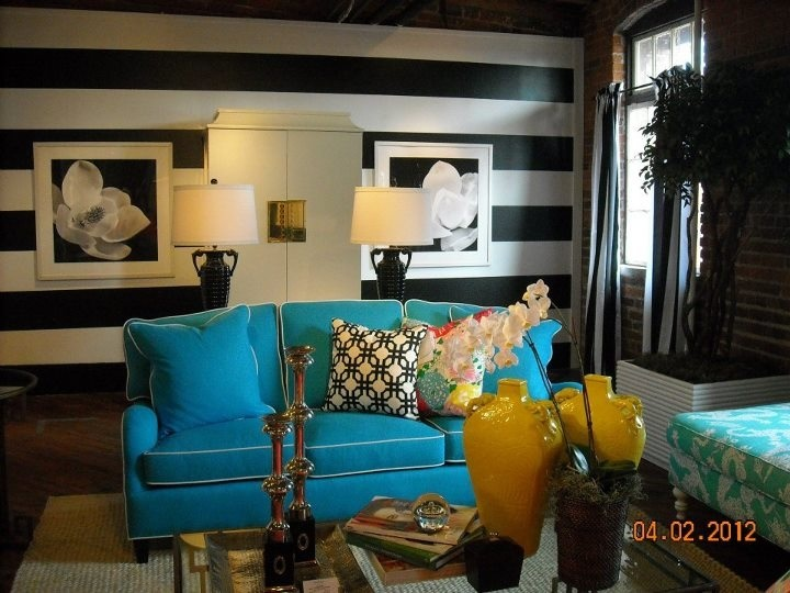 Turquoise sofa against the horizontally striped wall = cool!