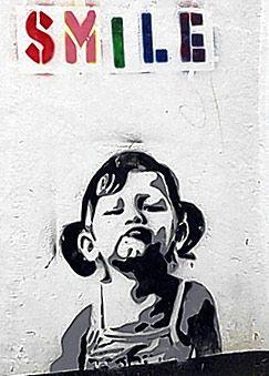 Banksy street art.  Smile.  000