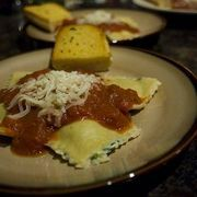 Ravioli is an Italian pasta shaped like squares or circles and stuffed with fillings before cooking. Most are familiar with meat raviolis, but there are unlimited versions of ravioli, including vegetarian kinds such as pumpkin ravioli. It is a food with a long history that started before ravioli pasta machines were available. Raviolis made by hand...