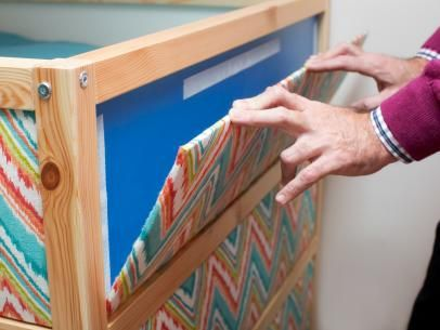Give a basic bunk bed a custom look with do-it-yourself fabric panels and a ready-made fabric awning.