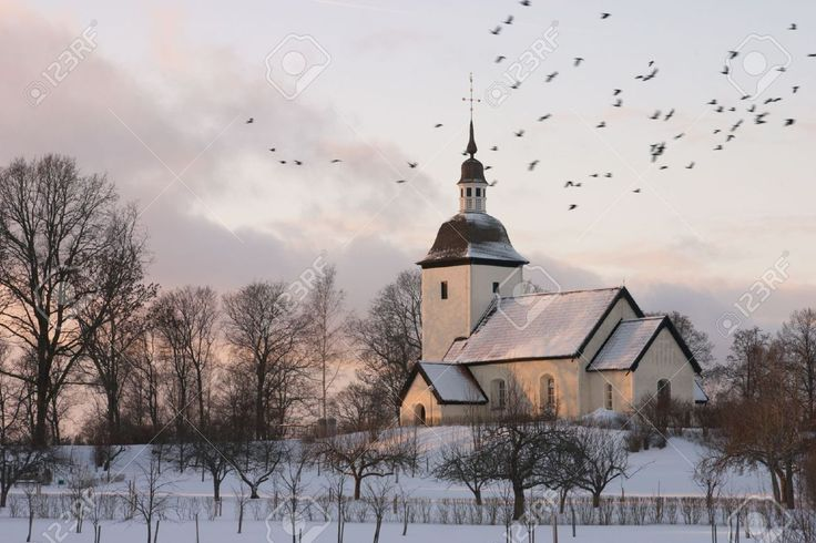 14569004-An-old-Swedish-country-church-surrounded-by-a-winter-landscape-at-dusk-with-a-flock-of-birds-flying--Stock-Photo.jpg (1300×866)