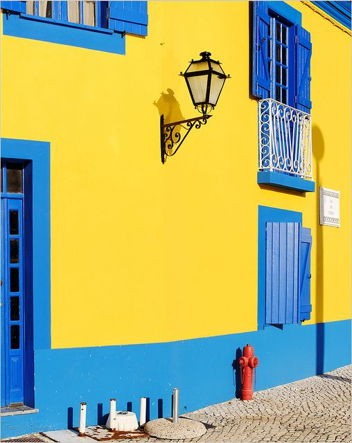 Traditional house painted in yellow and blue in Aveiro
