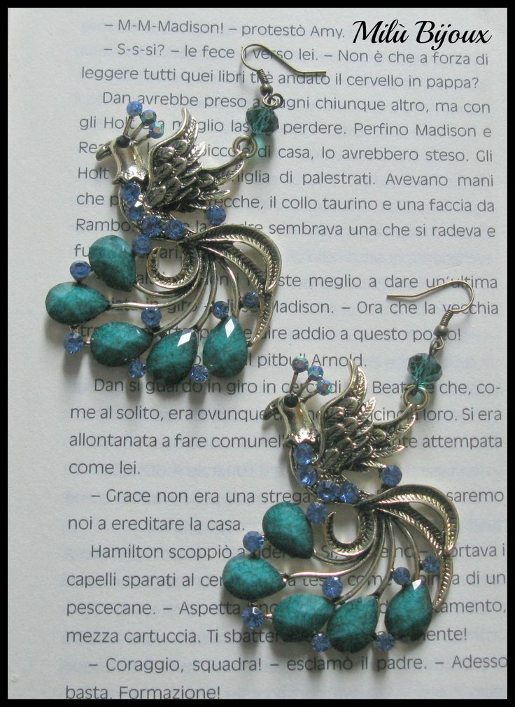 Peacocks with blue and green colored stones