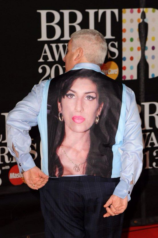 Mitchell Winehouse wearing Amy's picture on the back of his shirt at the 2013 Brit Awards.