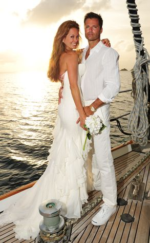 Brooke Burke from Celeb Wedding Dresses  The Dancing With the Stars host married longtime love David Charvet in a beautiful white backless Chantilly lace over silk georgette gown designed by Mark Zunino, paired with Jimmy Choo Fairvew crystal-embellished sandals.