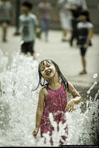 One summer day, she splashed about & giggled, and everyone around her had sore cheeks from smiling so big in response.