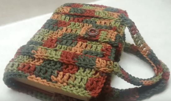 """It is not often you come across a pattern for a crochet book carrier for an """"old-fashioned"""" hardcover book. Watch this great video tutorial NOW ..."""