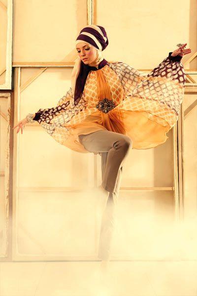 Chiffon silk kaftan tunic by Studio 133 Biyan. Khaki jodhpur pants by ammarahijabi. Floral Swarovski filigree ring and bracelet by LE CIEL. Scarf stylist%u2019s own.