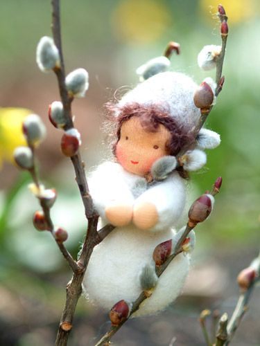 willow-catkin fairy made of wool roving.