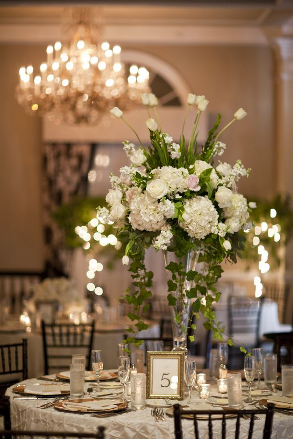 645 best flower centerpieces images on pinterest floral tall white wedding centerpiece junglespirit Choice Image