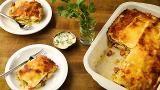 Poached chicken, bouillon, cream cheese and mozzarella make a fabulously creamy stuffing for this rich lasagna. Spaghetti sauce and more mozzarella are baked over the top.