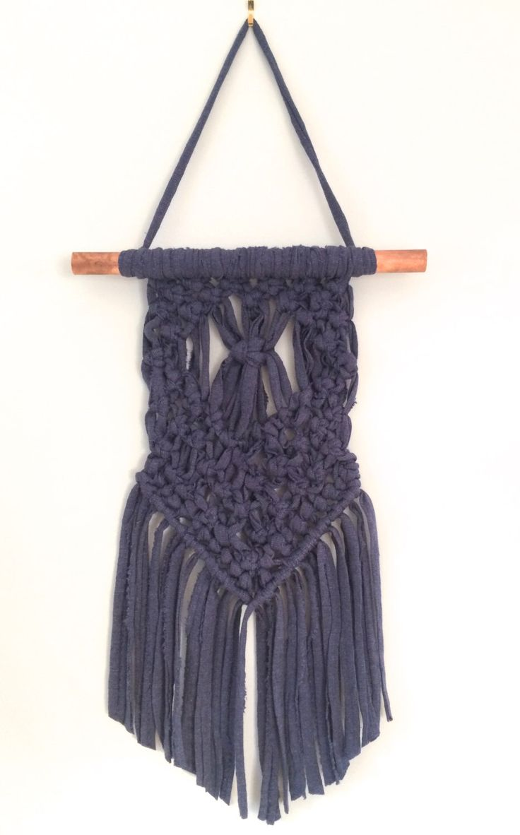 A personal favourite from my Etsy shop https://www.etsy.com/au/listing/457315430/navy-and-copper-macrame-wall-hanging