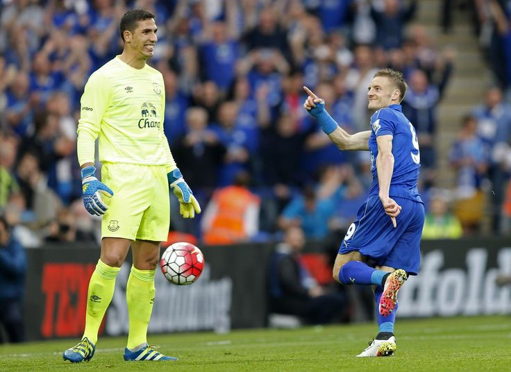Jamie Vardy gestures towards Everton's Joel Robles after scoring the third goal for Leicester from the penalty spot