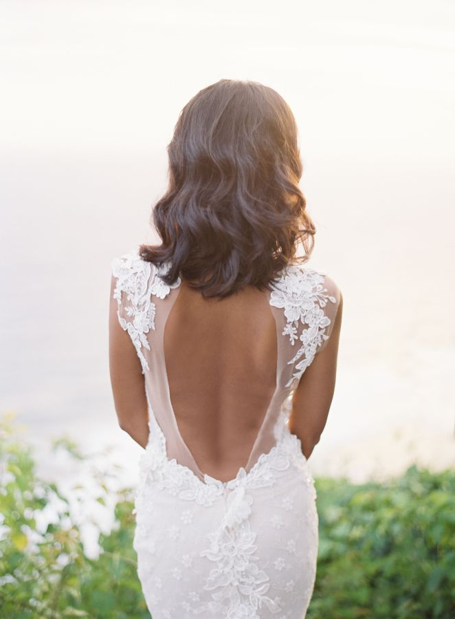 Peekaboo back wedding dress: http://www.stylemepretty.com/2017/04/27/tropical-wedding-inspiration/ Photography: Oliver Fly - http://oliverfly.com/