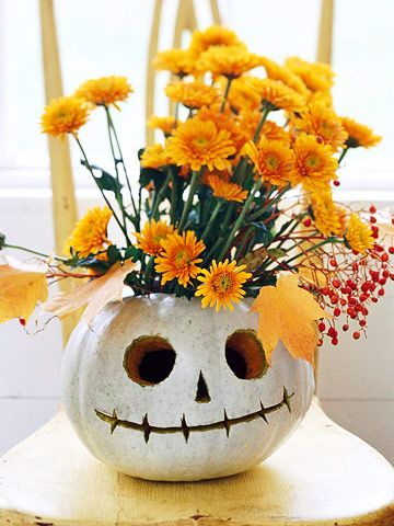 Jack-o'-Lantern Flower Vase        Ditch the standard candle and brighten up your jack-o'-lantern with an arrangement of bold-hue harvest flowers. Cut the stems, arrange in a small vase, and set inside a carved pumpkin. A white Lumina pumpkin carved with a skeletal face makes this arrangement extra spooky.: