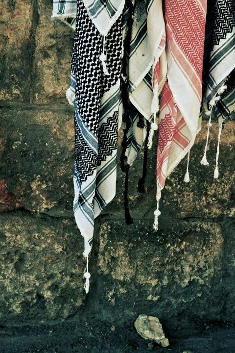 "《 The keffiyeh كوفية‎, meaning ""from the city of Kufa"" (also known as a hattah)…"