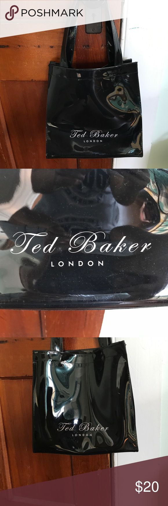 Ted Baker handbag Medium sized Ted Baker handbag. Authentic designer handbag. Very sturdy and durable. In great condition. One mark under the label on one side (as shown in picture) not really even noticeable. Never used ( scratched from storage). Has a zipper inside and very open tote like inside. Ted Baker London Bags Totes