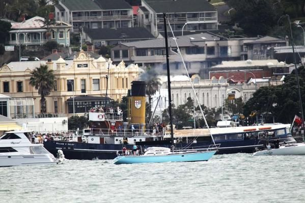 The tugboats race around North Head to the finish off at Devonport Wharf.