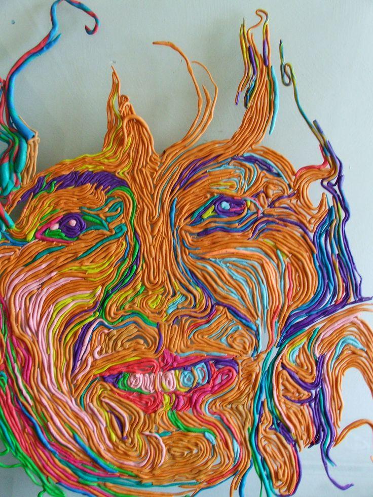 Self portrait using plasticene on glass by Wilhelmina Wegman