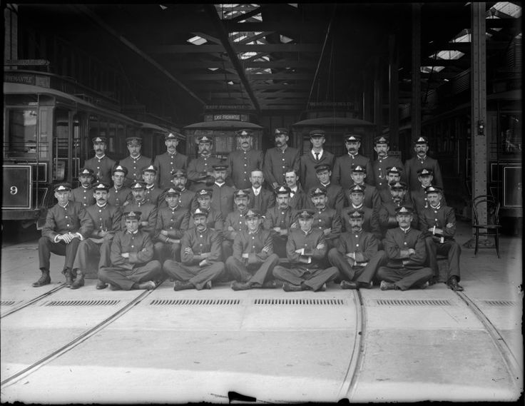 010130PD: Employees of Fremantle Municipal Tramways in uniform, 1905-1906. Tramways staff posing outside the carbarn. The Manager/Engineer, Albert Mitchell, is in the centre of the second row from the back. http://encore.slwa.wa.gov.au/iii/encore/record/C__Rb1765307__S010130pd__Orightresult__U__X3?lang=eng&suite=def