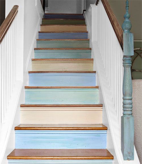 """Interior designer Lisa Teague set the palette for her whole house by brushing a spectrum of shades on the risers of her staircase—the first thing people see when they walk in the door. """"I wanted to make a statement, but a subtle one,"""" she explains. To achieve a lightly weathered effect, Teague mixed glaze into the paint. Plus: 5 more ways to add color to your home »   - CountryLiving.com"""